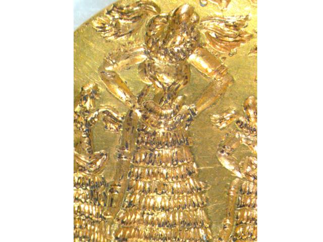 Microscope image of gold signet ring: goddess in a worship scene